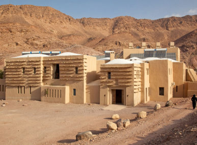 An exterior view of the sandy-coloured Feynan Ecolodge
