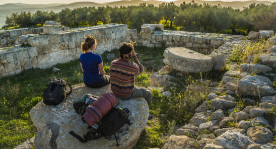 Palestine, March 2015. Sebastia offers thousands of years of local history. The town is built on the site of the biblical city of Samaria. Atop the archaeological hill, surrounded by Roman ruins, a Greek Orthodox church marks the site associated with the discovery of Johnís head. The Abraham Path is a long-distance walking trail across the Middle East which connects the sites visited by the patriarch Abraham. The trail passes through sites of Abrahamic history, varied landscapes, and a myriad of communities of different faiths and cultures, which reflect the rich diversity of the Middle East. Photo by Frits Meyst / MeystPhoto.com for AbrahamPath.org