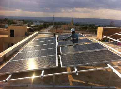 Installing solar systems as part of the eco-village project in Fefa, Jordan