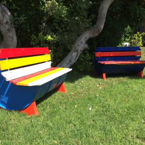 Hussein's bench seats add color to yards and public places