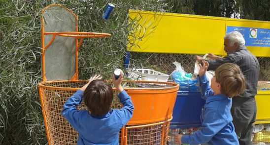 Local children practise their basketball and rubbish disposal skills at one of Amal's customized bins