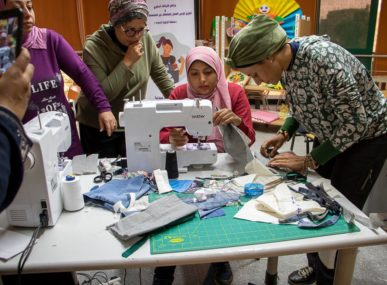 Green Fashion uses material from damaged clothes and fabric cast-offs to make patchwork garments, bags, and accessories.